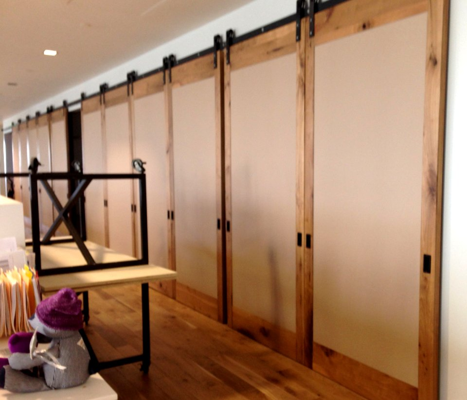 Large sliding doors 11 in a row as room dividers sliding barn door hardware