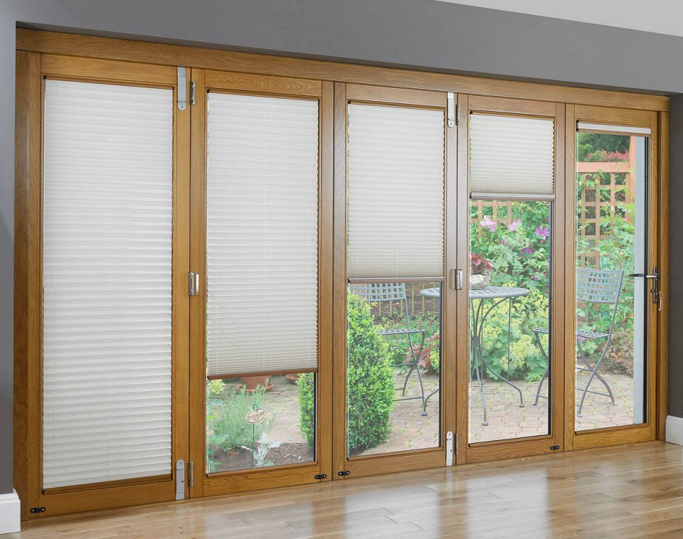 Sliding and bifolding wood doors large sliding doors for Sliding walls and doors